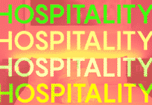 "the word ""hospitality"" repeated over a hotel room"
