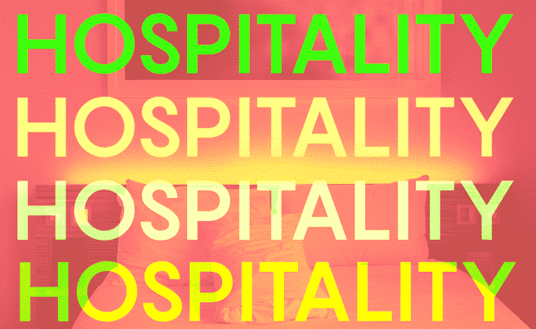 """the word """"hospitality"""" repeated over a hotel room"""