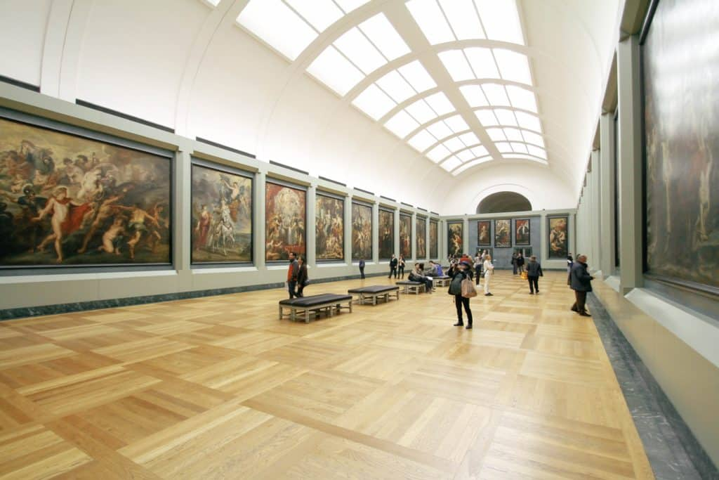 A photo of a long, art-covered hall at the louvre, a potentially smart museum