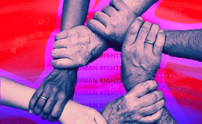 Image of people holding hands over human rights