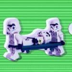 Image of Storm Trooper Legos Carrying Another on a Stretcher who is Wearing a Wearable Device