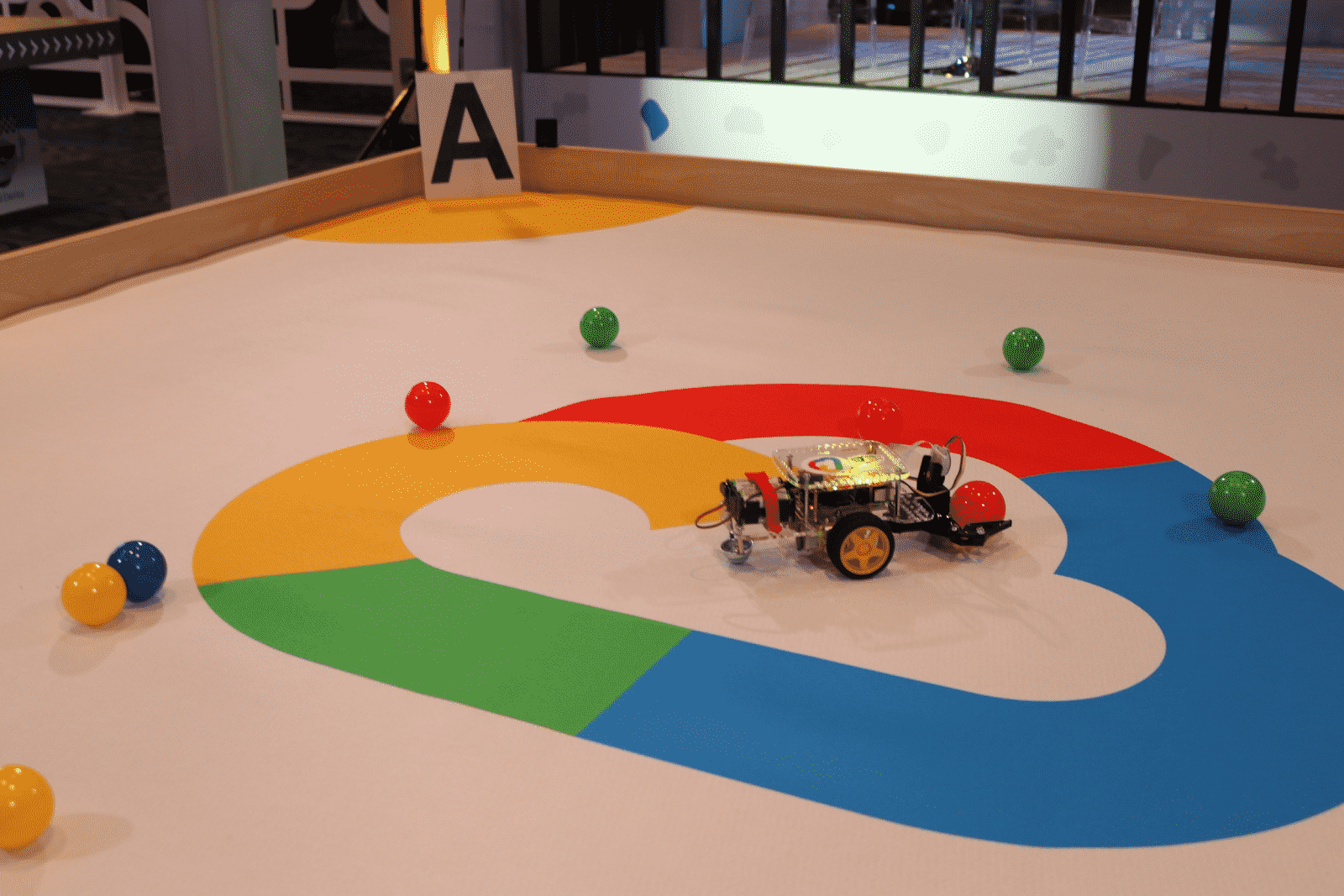 An image of the Leverege robot playing in the testing arena