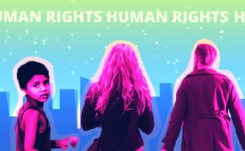 "Image of three humans standing in front of a city skyline with the words ""Human Rights"" spanning across the tops"