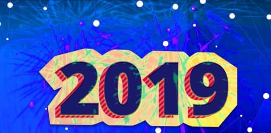 """Image of """"2019"""" over fireworks and an illustration of a connected network"""