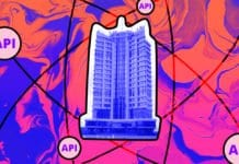 Image of an office building with a graphic of atom behind it