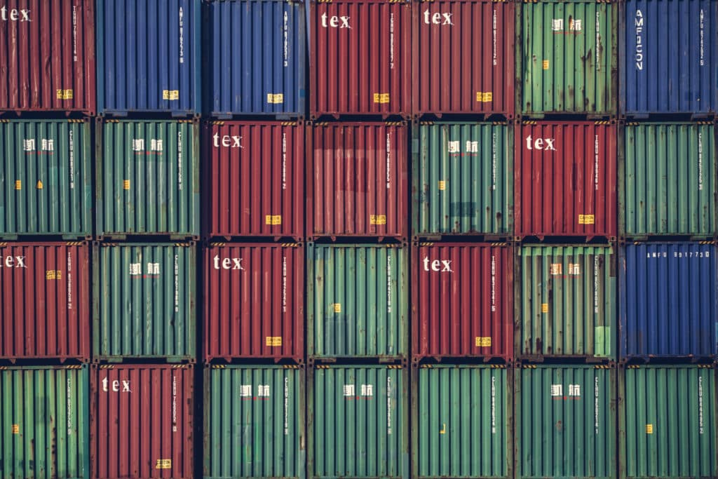 A photo of many stacked shipping containers.
