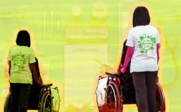 Woman, likely a caregiver, pushing a wheelchair