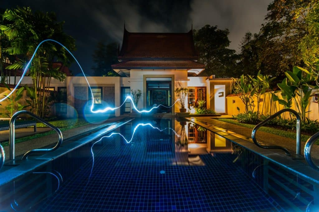 Image of a backyard pool with an energy current running alongside it and into the house.
