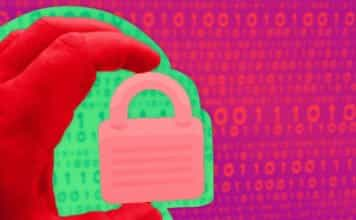 Image of a person holding a padlock over binary code