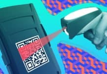 Image of a scanner scanning a QR code on an IoT device