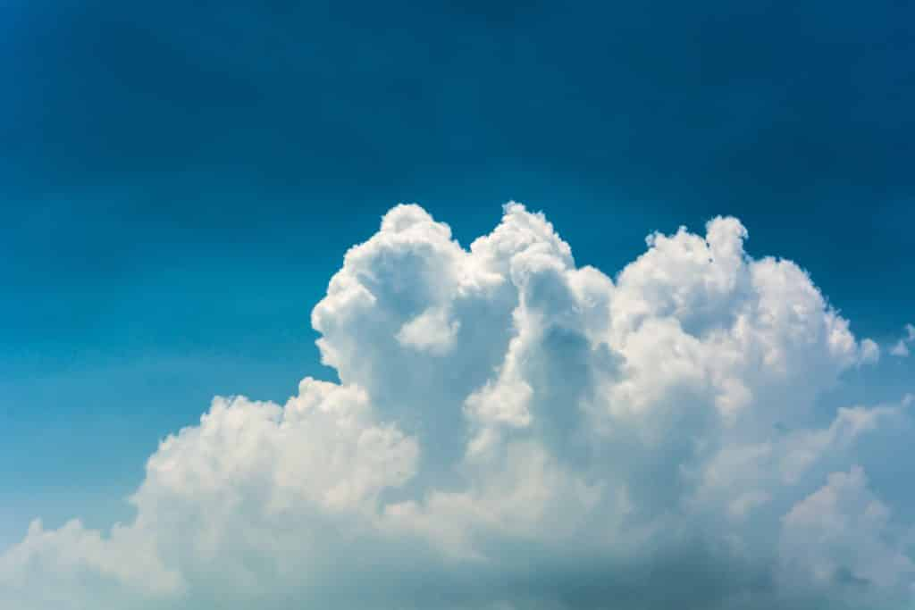 White clouds against a blue sky.