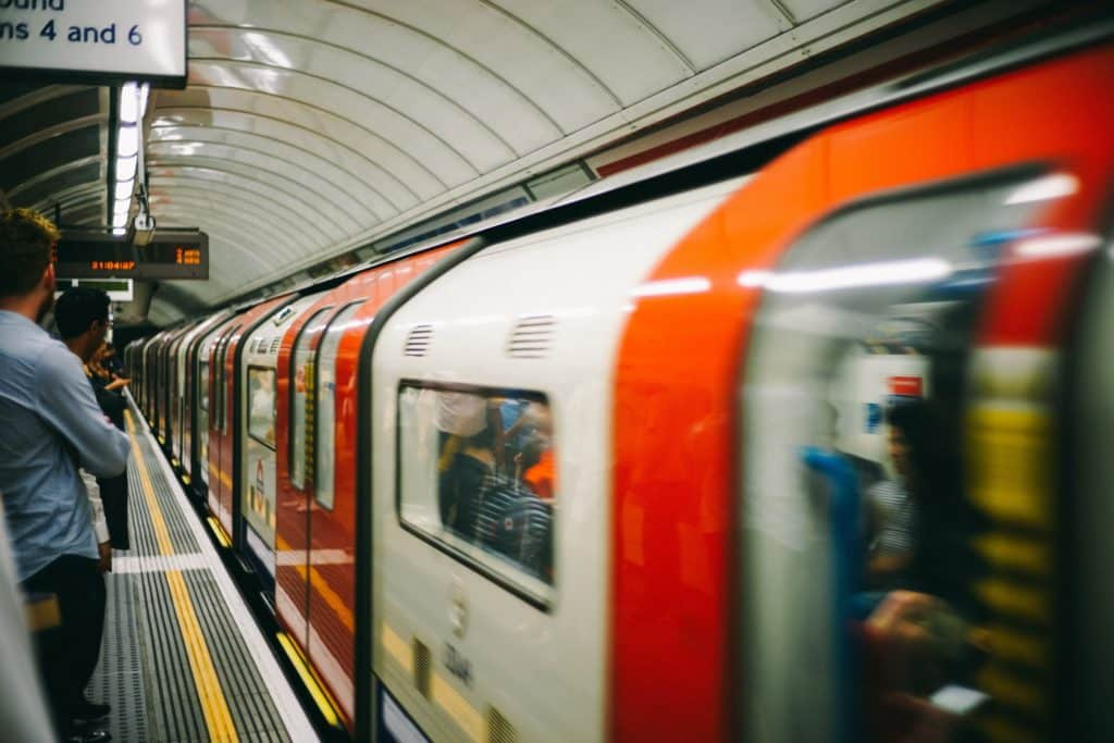 A tube train passes a platform