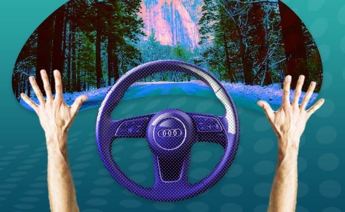 Image of a person with their hands off a steering wheel of a car