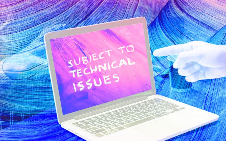 "Laptop with the text ""Subject to Technical Issues"""
