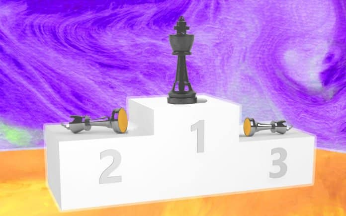 A podium with three chess pieces on it.
