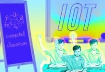 "Image of a student raising his hand in frot of a chalkboard that say ""IoT"""