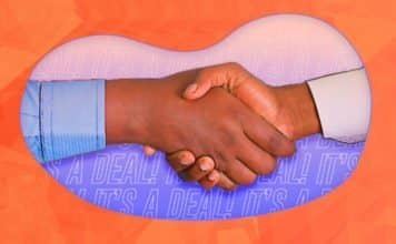 """Image of two people shaking hands with """"It's a deal!"""" written in the back"""