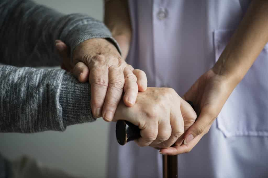 a carer supporting an elderly person