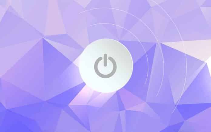 Power button on a purple geometric background