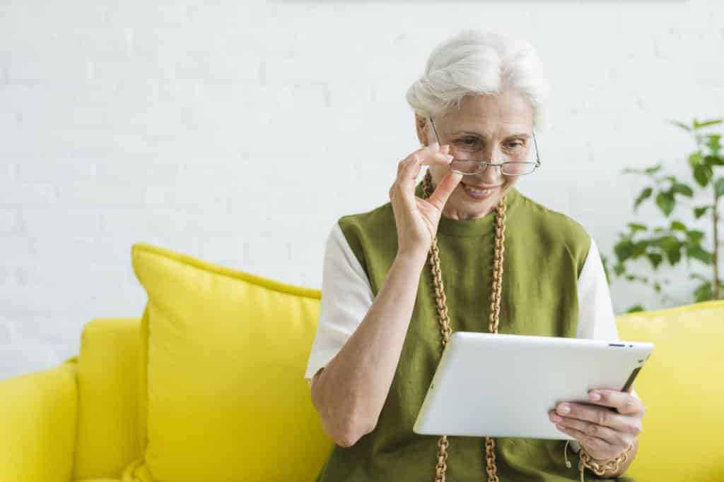 an elderly woman using a tablet