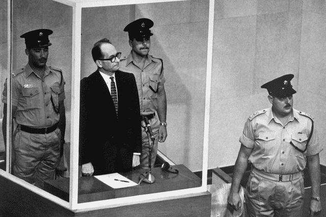 An image of Adolf Eichmann on trial in 1961