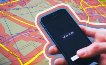 Image of a city map and a phone with the Uber app opened