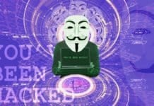 "Anonymous Mask holding a computer that says ""You've Been Hacked!"""