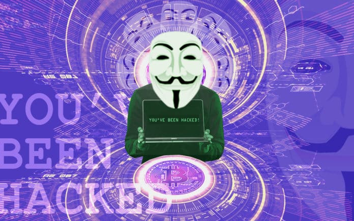 Anonymous Mask holding a computer that says