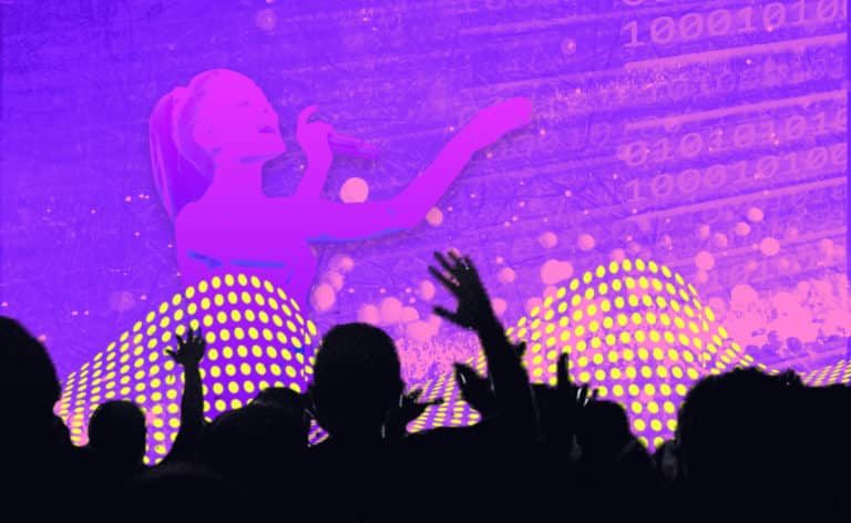 Image of hands up at a concert