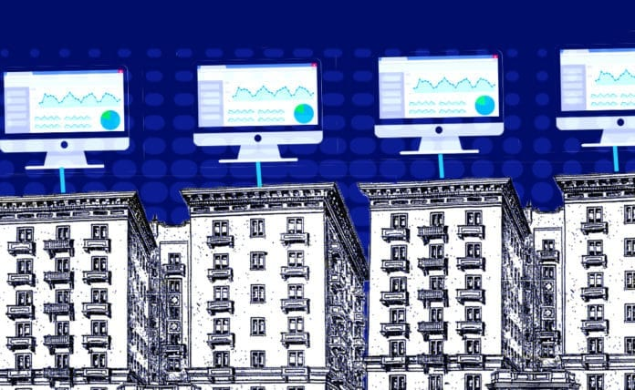 Image of apartment buildings with analytics dashboards on desktop computers hovering over the buildings