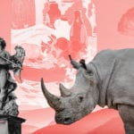 A rhino and a an art statue