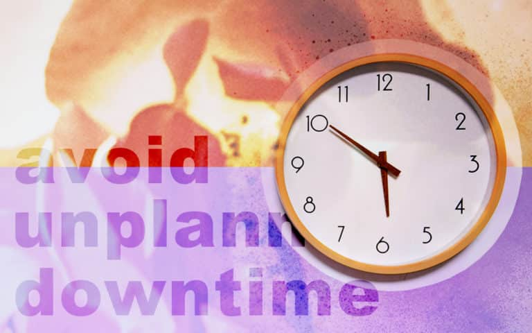 "A clock and the words ""avoid unplanned downtime"""