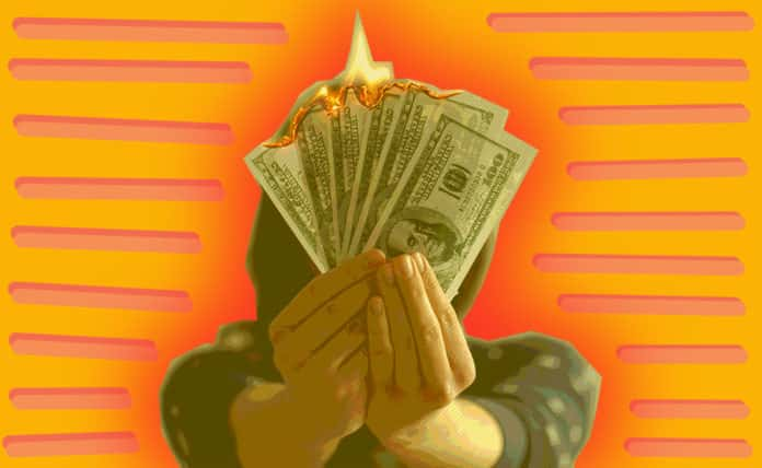 Person holding burning money