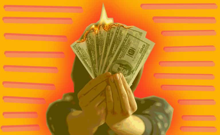 Person holding burning money