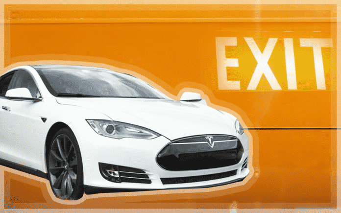 A Tesla car on an orange background with the word