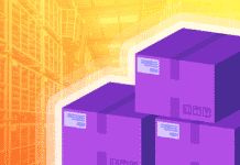 Three shipping boxes and a warehouse background
