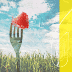 A corn field and a fork with a strawberry