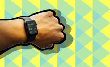An arm with a smart watch on it casting a shadow