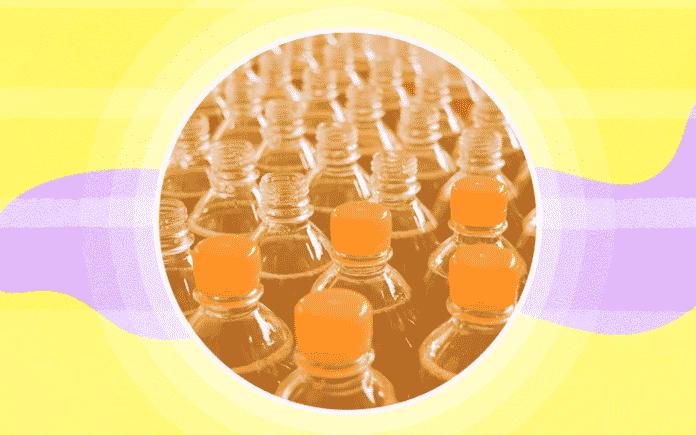 Numerous plastic water bottles with orange caps