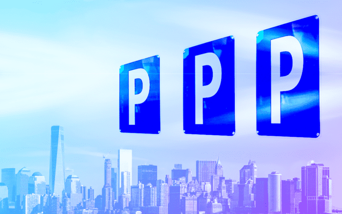 Three parking signs on a backdrop of a city
