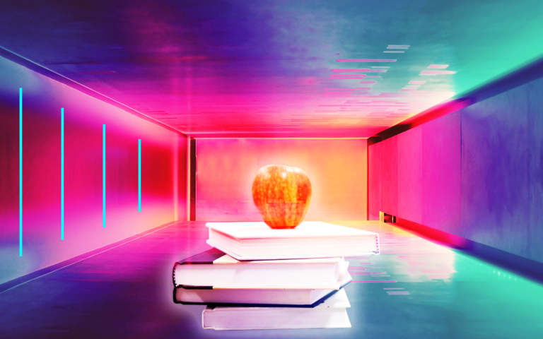 A stack of books with an apple on top