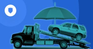 car on tow truck with umbrella over it