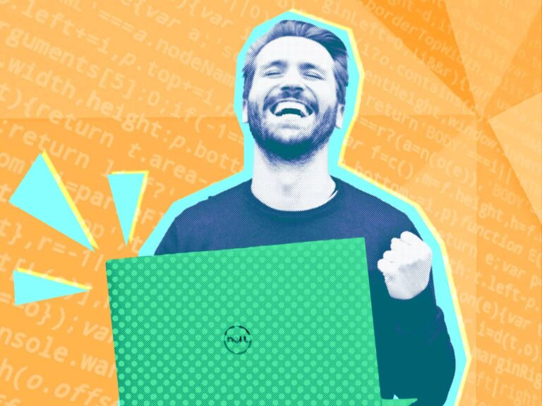man with laptop celebrating code success