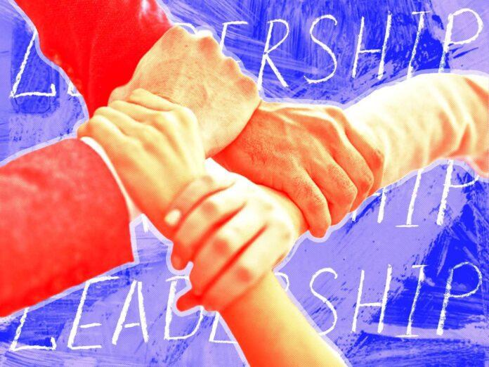 arms linked leadership teamwork